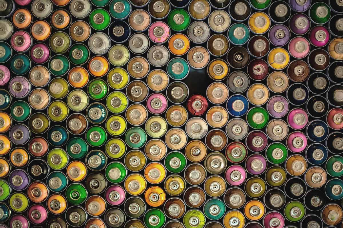 An assortment of spray paint cans.